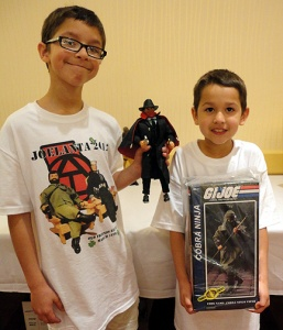 Robert's sons Gus (l) and Ben (r) hold up their 1st-place winning custom figure of