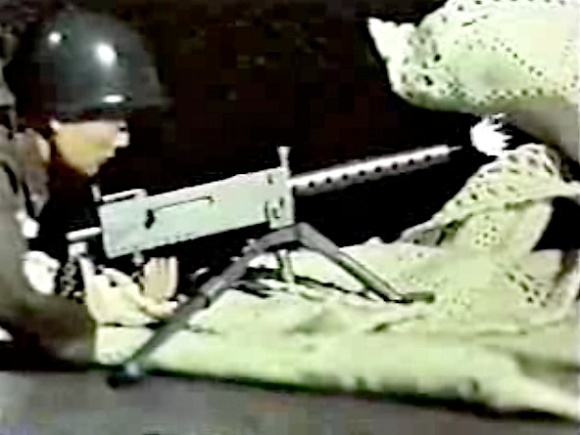 "In addition to full-blown, stop-animation, this episode of Comet-San also includes special effects, smoke, and even cartoon animation. Here, an Army Joe fires his ""50 cal"" at the two annoying brats. HA"