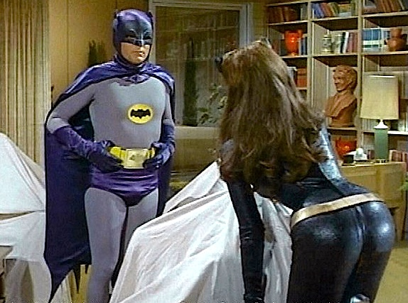 Adam West and Julie Newmar (as Catwoman) get better acquainted in this scene from the 60s classic TV show. (Photo: Warner/DC)