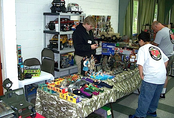 "Man-o-man! Fans had so much great stuff to choose from! There's a minty-fresh 5-Star Jeep, some High Altitude Infiltrators, a 1:6 Hummer and a Love Bug Beetle, the list of ""Joe-goodies"" goes on and on. Look at all that great stuff! (Photo: DFW GIjOE Collector's Club)"