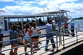 Tourists boarding  the ferry to visit the memorial. (Photo: armchairhawaii)