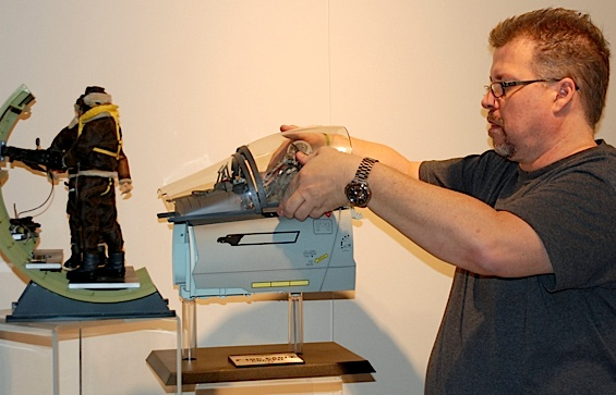 GIjOE collector, Tearle Ashby, sets up his F-15 Strike Eagle cockpit diorama in the musuem. (Photo: US Arrmy)
