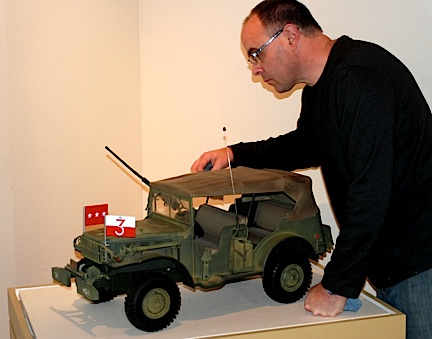 NYS Military Museum curator Courtney Burns assists Ashby with the arrangement of his collection. (Photo: US Army)