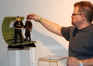 Ashby poses his figures inside a B-17 gunner diorama. (Photo: US Army)