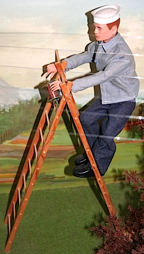 Closeup examination of the five figures confirmed that they are indeed vintage 1960s figures in correct uniforms and equipment. However, props such as the telephone pole and wires, plus this fragile-looking ladder are clearly handmade. (Photo: Chris Voegelin)