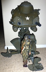 "It's unclear from these prototype photos, but it's possible the legs of the ""Battle Suite"" walker may have been intended to fold up, or ""transform."" Shown with included figure (in shrink-wrap). (Photo: usarules) Click to enlarge."