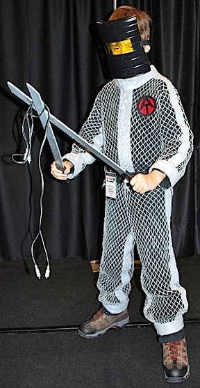 "One of the coolest vintage GIjOE costumes we've ever seen was this superb ""High Voltage Escape""  worn by a creative young fan at the 2012 JoeCon. Dig that mask and the the mesh suit. WOW. (Photo: GIJCC)"