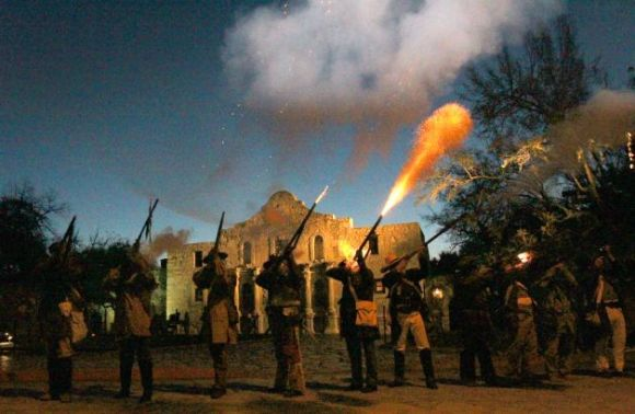 Alamo reenactors fire a volley in honor of the fallen defenders of the Alamo, 177 years ago today. (Photo: JOHN DAVENPORT, San Antonio Express-News)