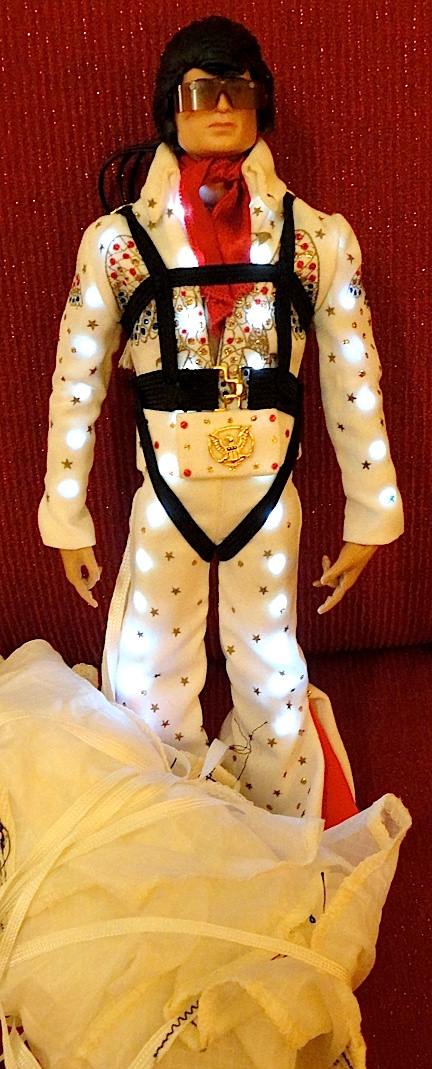 "Jack Hall's custom ""Flying Elvis"" figure was the unofficial ""star"" of Joelanta 2013. Hall's unique combination of Hasbro, Mattel and Auto Zone accessories, resulted in a one-of-a-kind custom figure you had to see to believe. For the record, ""Flying Elvis"" made 5 successful jumps (in full light-up mode) during Saturday night's parachute drop event in Atlanta and suffered no damage. ""Thank you. Thank you very much."" (Photo: Mark Otnes)"