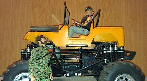 "The Land Adventurer asks Ron's ""Mini Me"" for a ride back to Adventure Team Headquarters in their new (custom) ""High Rider"" Jeep. Fully RC, Ron's motorized monster is ready for any challenge. (Photo: Ron Stymus)"