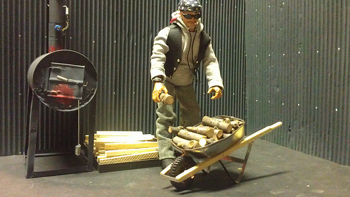"Ron's ""Mini Me"" loads up his new scratch-built 1:6 scale wheelbarrow with cords of wood. (Photo: Ron Stymus)"