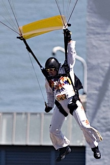 "A real-life ""Skydiving Elvis"" prepares to land at a recent T-Mobile event in San Franciso. (Photo;"