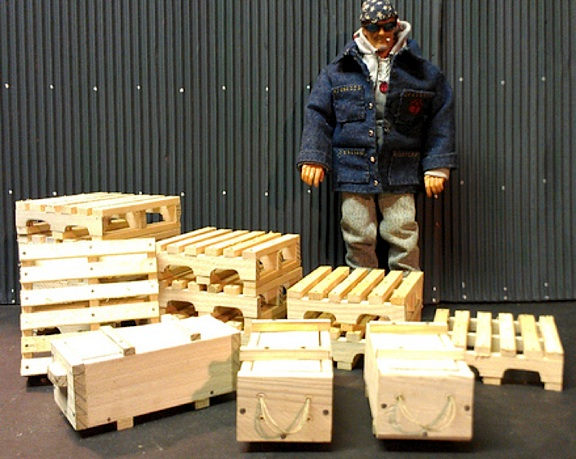 "Ron's ""mini-me"" poses next to a stunning variety of scratch-built crates and pallets. What realism! (Photo: Ron Stymus)"