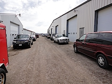 At the auction site, door after door led into a variety of featureless metal buildings. There were no signs. No arrows. Nothing. Whatever treasures lay beyond remained hidden from view. The hunt continued! (Photo: Mark Otnes)