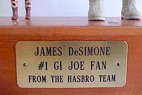 The base of the figure awarded to James bears a plaque with this inscription from Hasbro. (Photo: James DeSimone)