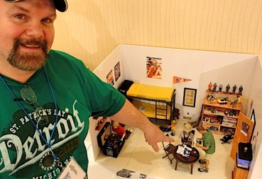 "Jack ""RatSix"" Hall, points to his 1st place-winning diorama, a miniature bedroom scene he dubbed,"