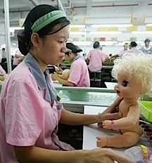 Chinese toy factory worker (average pay .75 cents per hour) assembles a blond-haired, blue-eyed doll for unknown customers living in far-off lands. (Photo: Reuters)