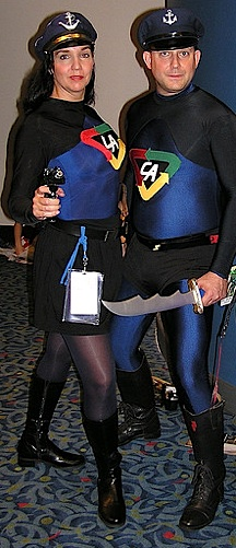 "Captain Action ""cosplayers"" seem to prefer traditional depictions of the two characters. In this case, Lady Action sports a skirt with hose, rather than the blue leggings. (Photo: samaritanx)"