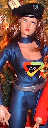 """Customizers have created their own versions of Lady Action. This one features a black beret instead of a cap, blue satin costume with matching collar and a silver belt, on a Cy Girl figure with auburn hair. Notice her custom """"LA"""" chest emblem and beret flash. (Photo: Neal Patterson)"""