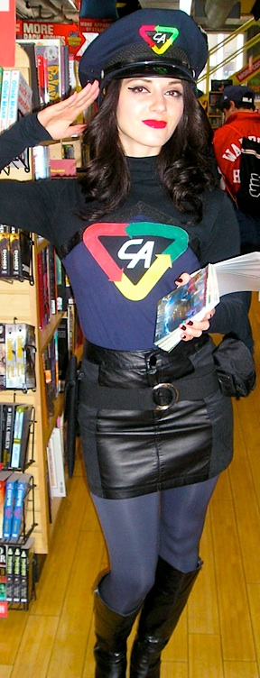 Professional models hired to promote Captain Action products are attired  in full-length blue and black body suits, set off with a leather skirt, belt and knee-high boots. Note the cap features a smaller CA logo. Will the action figure's chest emblem read CA or LA? Hmm... (Photo: Round2)