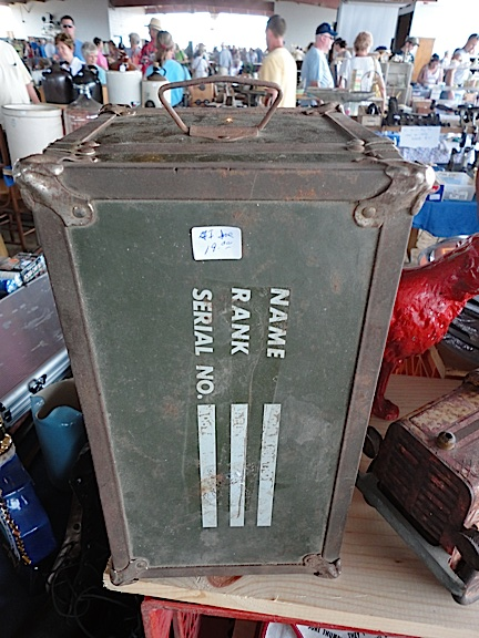 "This all-metal ""footlocker"" was misleading stickered as being ""GIjOE"" by its seller, but in actuality it was MUCH larger '60s-ish knock-off. Its condition and graphics were in pretty fair shape, and looking back at it now, we regret not making an offer for it. Oh, well! (Photo: Mark Otnes)"