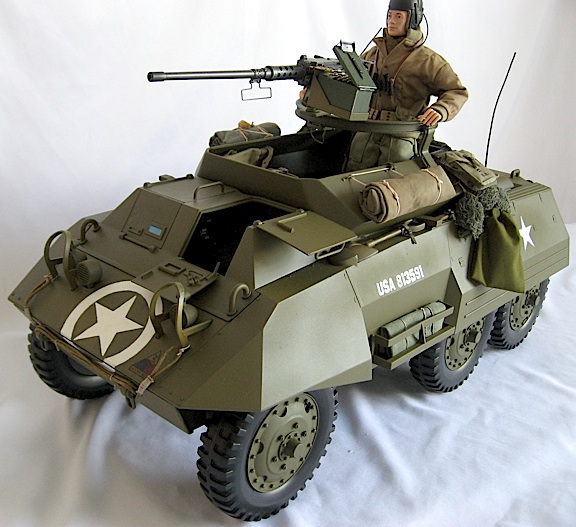 "Robert's superb M8 armored car was upgraded and customized with a new OD paint job, ""circle-n-star"" decals from Patches of Pride, storage racks, .50 cal machinegun and a GREAT looking custom GIjOE driver. WOW! (Photo: Robert Jason)"