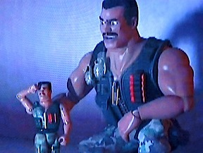 "In Pixar's Toy Story of Terror, the GIjOE-based character, ""Combat Carl"" was depicted in both scales. In this screenshot, the larger, 1:6 scale version, urges on his smaller buddy, reminding him that ""Combat Carl Never Gives Up!"""