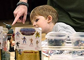 This is what it's all about. At the show, a father points to some toys while explaining some little American history to his son. You can buy the toys, but you can't buy such precious moments. (Photo: DFWGCC)