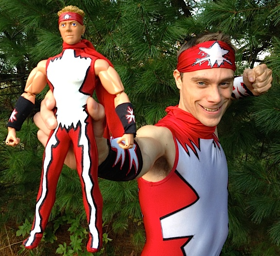 "John Stork, 27, aka ""Hyper-Strike"" from the 2007 SyFy series, Who Wants to Be a Superhero?, in a photo taken exclusively for The Joe Report on October 8, 2013, reveals Stork has hardly aged a day since the show ended. At our request, he donned the original costume tights created for him by the show's wardrobe department, and holds up the custom-made action figure of himself built by Herobuilders.com. Outstanding! (Photo: John Stork)"
