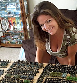 "Tina believes posing alongside the items in her ebay listings will make them—more appealing—to customers. Here she poses with a bodacious ""rack"" full of military miniatures for sale. (Photo: smileygirl2012)"