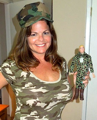 "As long as Tina keeps her sexy product photos PG-rated, she's not likely to ""arouse"" the ire of ebay execs. Here, a very lucky Marine GIjOE (currently for sale) inches closer and closer to her—enthusiastic personality. Yeah, that's it. (Photo: smileygirl2012)"