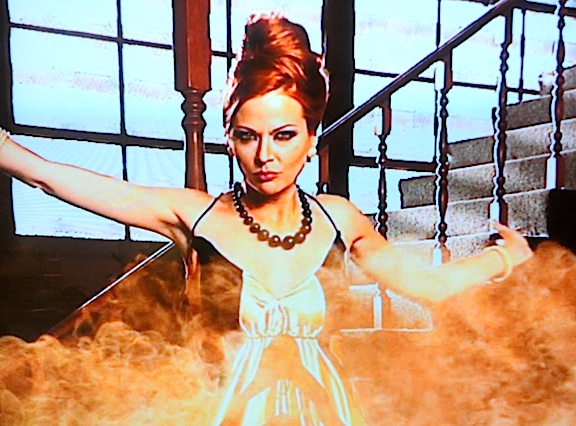 "Easily the most popular villain to appear on the show, the delightfully evil, ""Bee Sting"" (played masterfully by actress Anna Easteden), wreaked havoc on the contestants by unleashing thousands of real bees and then dumping barrels full of syrup on them, ruining their superhero costumes. (Photo: Syfy)"