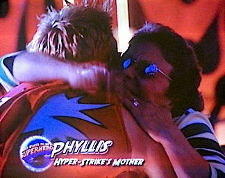 Phyllis Stork embraces her son after surprising him during taping of the final episode of WWTBASH, Season 2. (Photo: Syfy)