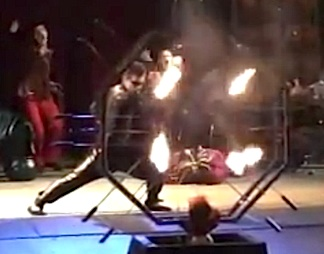 "In this screenshot from a ""Circus Smirkus"" video, Stork prepares to run and dive through a ring of swords and fire. (Photo: David Duffin)"
