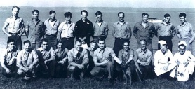 "This historic WWII photo of Spence (5th from left, back row in dark uniform) and his fellow members of the very first OSS clandestine underwater team, was taken at their top-secret training grounds, ""Area D,"" outside of Quantico, VA, in 1943. (Photo: guardianspies.com) Click to enlarge."