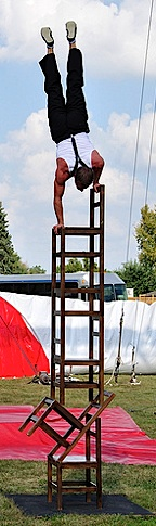By the end of the feat, Stork executes a hand-stand on top of 5 stacked chairs. AMAZING! (Photo: Randy)