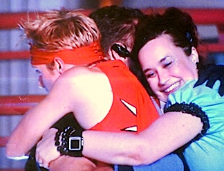 "Stork sharing a final hug with fellow contestants Jarret ""The Defuser"" Crippen and Melody ""Hygena"" Mooney. (Photo: Syfy)"
