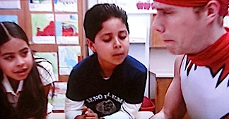 In a rare mistep, Stork chose to reveal his secret identity to children in the classroom. (Photo: Syfy)