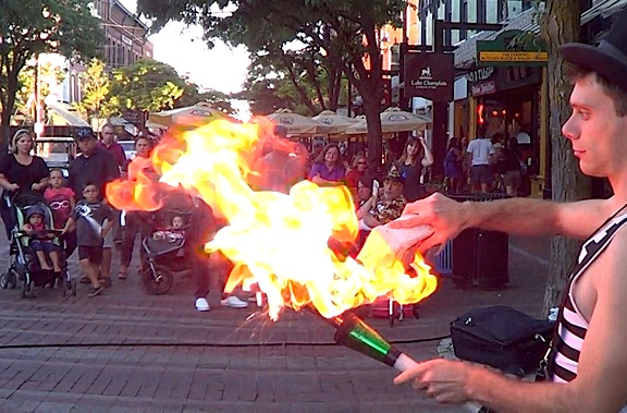 As daring as ever, Stork works fearlessly with knives, dizzing heights, and even fire. Here, he lights three juggling clubs in preparation for his next feat, during a recent street performance in Bridgehampaton, VT. (Photo: John Stork, exclusively for The Joe Report)