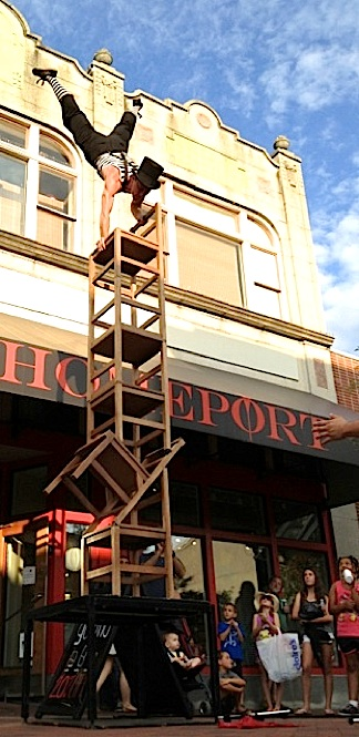 "Working as a street performer, or ""busker,"" John Stork was photographed recently performing his amazing stair-stacking routine in Burlington, VT. (Photo: John Stork, exclusively for The Joe Report)"