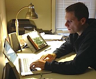 "Stork writing a new ""Ultimate Manga"" script in his office. (Photo: John Stork)"