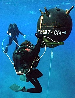 Members of a Underwater Demoltions Team practice disarming an anti-ship mine using skills and equipment first developed by John Spence and others in the US Navy and OSS (Photo: USN)