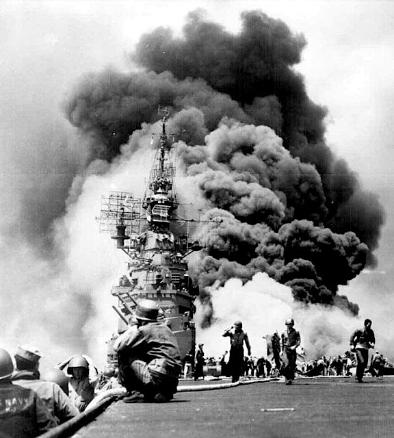 Spence's wish to get back into combat was granted and his Destroyer, the USS Wadworth was the scene of repeated kamakazi attacks during the Battle of Okinawa. Above, crewman of the aircraft carrier, USS Intrepid, scramble for cover as a kamakazi plane strikes the ship. (Photo: US Navy)