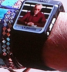 "A super-closeup of Parthenon's ""wrist communicator"" with video of Stan Lee. (Photo: Syfy)"