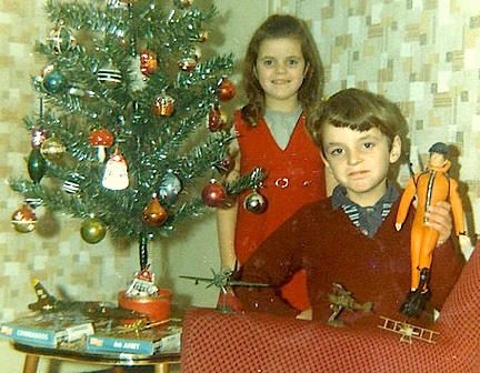 "Pride of GIjOE ownership crosses all borders. In a charming photo titled, ""Me with Action Man and Sister, 1970,"" a young Brit and his sister pose with some of his gifts next to their table-top Christmas tree. But...what did Sis get? (Photo: jiulong)"