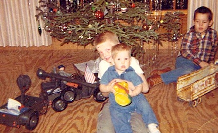 As we already know, the GIjOE 5-Star Jeep was a popular Christmas gift for many years. Little boys Mike and brother Darron take a break playing with theirs to hold up baby Kent, Christmas day, 1967. (Photo: Alphadog)