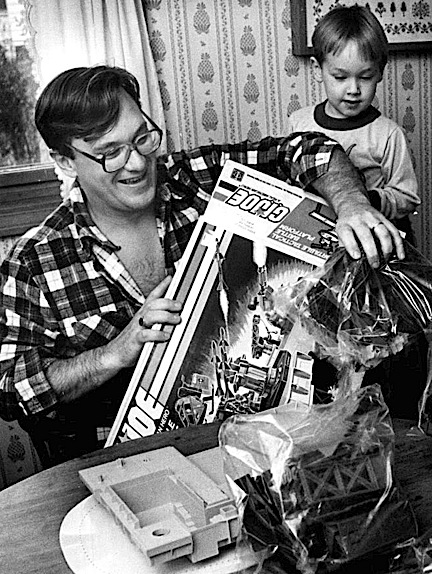 In this superb candid shot taken on Christmas morning, 1986, we're not sure who's happier, or who's getting the gift—the Father or the Son? Either way, Go, JOE! (Photo: Ted Fitzgerald)