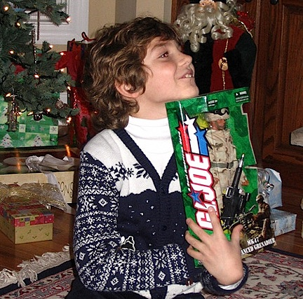 "Giving the gift of a new 12"" GIjOE (when available!) continues to work it magic with children, as proven in this wonderful photo of ""Clay"" taken on Christmas morning, 2005. (Photo: ShanVan)"