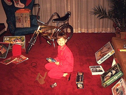 This lucky kid had great reason to be smiling. In addition to receiving an Adventure Team HQ, a 6-wheel ATV, and a GIjOE Deep Sea Diver equipment set, he's also received a brand-new Schwinn Stingray bicycle. All Christmas morning, circa 1970. WOW! (Photo: Jelene Morris)