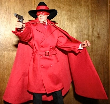 "Jason Stone is a big fan of the classic comic book superheroes. He ask us to make him a cape and trenchcoat for his version of the Crimson Avenger. He customized the craft store cowboy hat, added the chain closure to the cape and the mask, and came up with a very sharp looking figure. ""Super"" job Jasonl!"